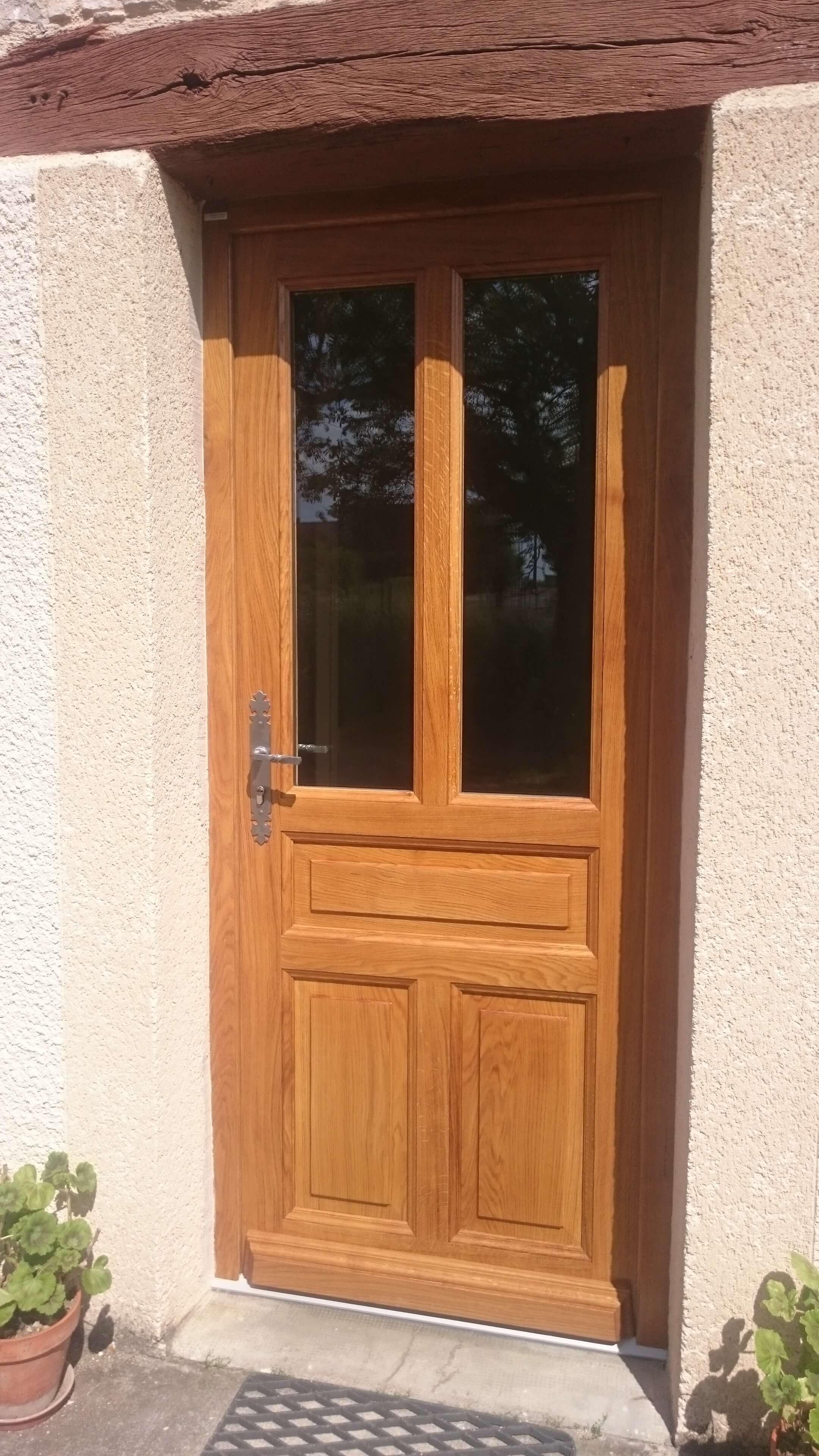 Menuiserie Figard - Fabrication sur mesure - Porte d'entrée - Chêne - Vesoul